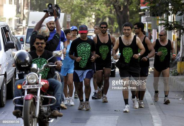 Greenathon Model turned actor Milind Soman runs in a Greenathon in Mumbai The event where actors like Rahul Bose are participating in the Greenathon...
