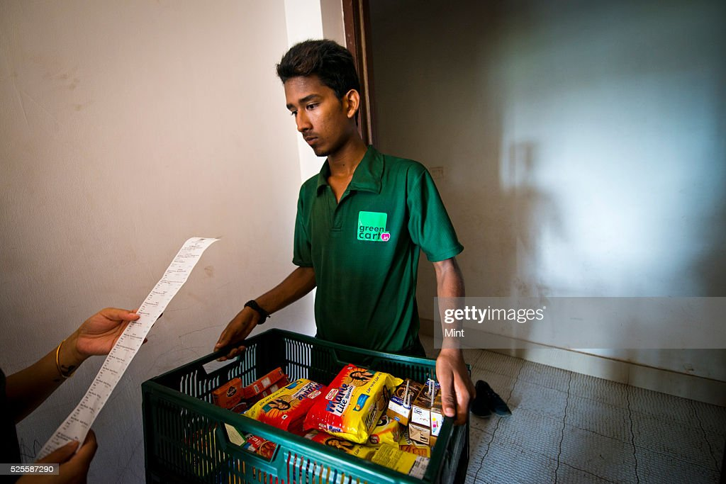 A Greencart's delivery guy delivering packages to a customer on May 21, 2015 in Mumbai, India.