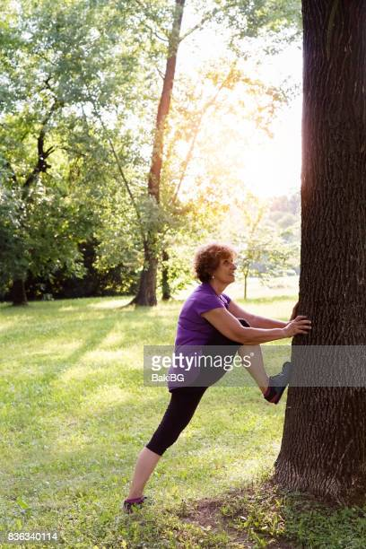 Greenery with an active senior woman