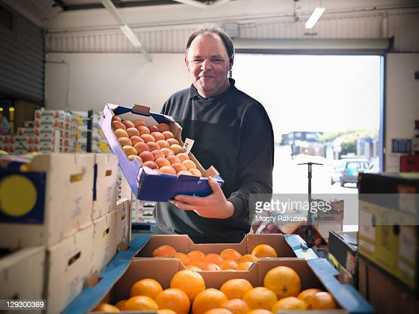 Greengrocer with apricots and oranges
