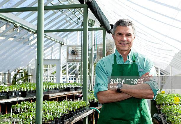 greenhouse gardener posing for camera