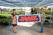 Greenhouse workers holding sign