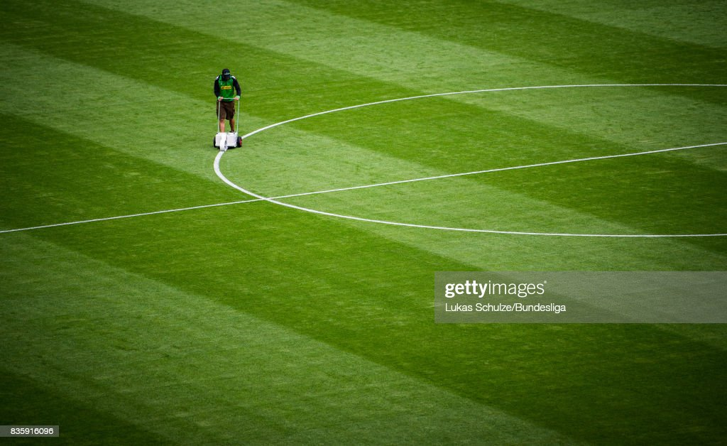 A greenkeeper marks the lines of the pitch prior to the Bundesliga match between Borussia Moenchengladbach and 1. FC Koeln at Borussia-Park on August 20, 2017 in Moenchengladbach, Germany.