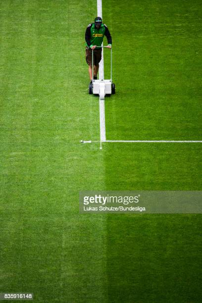A greenkeeper marks the lines of the pitch prior to the Bundesliga match between Borussia Moenchengladbach and 1 FC Koeln at BorussiaPark on August...