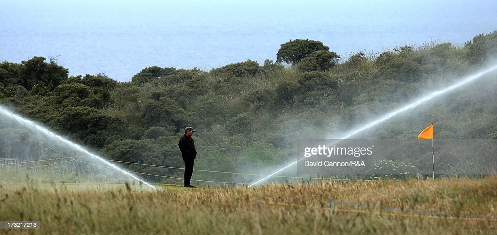 A greenkeeper watering the 15th green area as a preview for the 2013 Open Championship at Muirfield on July 10, 2013 in Gullane, Scotland.