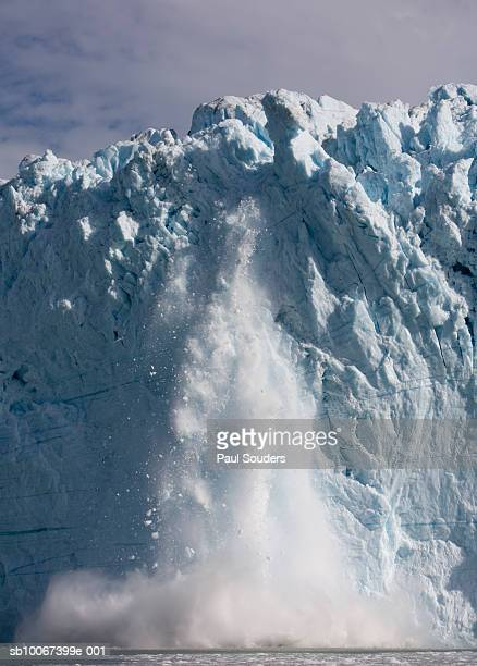 Greenland, Disko Bay, Icebergs calving with splash from active face of Equip Sermia Glacier