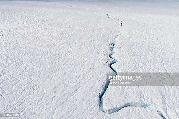 A fracture line dissecting the surface of the ice on the Greenland Ice Sheet.