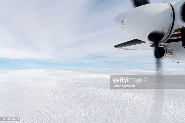 The propeller of a small plane flying over the Greenland Ice Sheet.