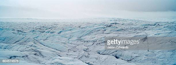 The frozen and barren wasteland of folded ice on the surface of the Greenland Ice Sheet.