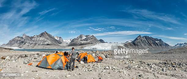 Greenland, Kulusuk, Mountaineers in tent camp at Schweizerland Alps
