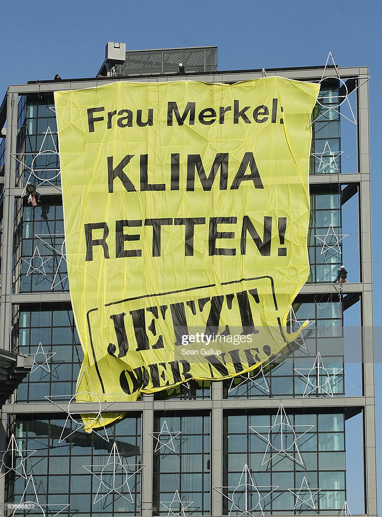 Greenpeace acitvists unfurl a banner that reads: 'Mrs. Merkel: Save the Climate! Now or Never!' on the facade of Hauptbahnhof train station on December 3, 2009 in Berlin, Germany. The banner refers to the upcoming summit on climate change in Copenhagen, where Chancellor Merkel will lead the delegation representing Germany.