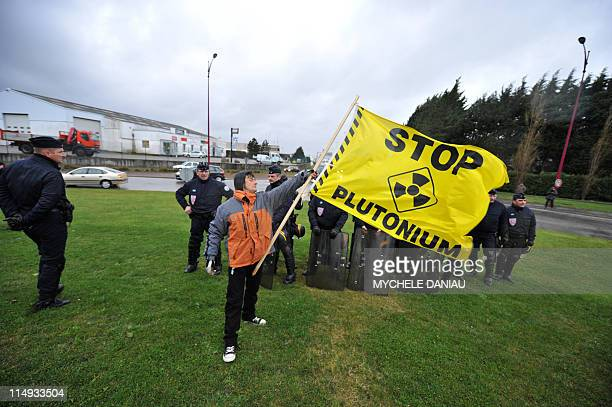 Greenpeace activists demonstrate in the Cherbourg harbour western France on March 3 protesting the transport of MOX fuel a blend of plutonium and...