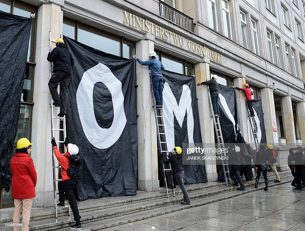 Greenpeace activists drape Poland's Economy Ministry in Warsaw with protest banners against the development of new open pit coal mines in Poland which they argue will claim a high environmental and financial toll on November 7, 2012.