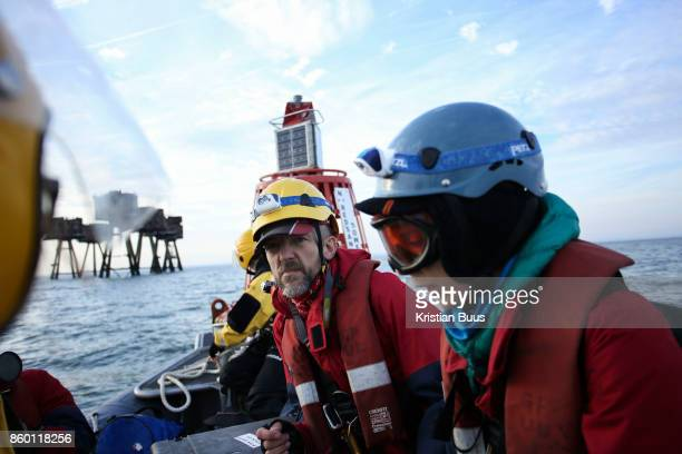 Greenpeace activists get ready to board the cargo ship at sea September 21st 2017 Thames Estuary Kent United Kingdom Greenpeace volunteers in kayaks...