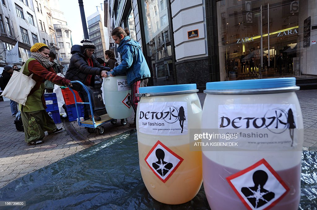 Greenpeace activists prepare for a protest action in front of Zara's store in Budapest on November 20, 2012. High street fashion brands are selling clothing contaminated with hazardous chemicals that break down to form hormone-disrupring or even cancer-causing chemicals when released into the emviroment, according to report released today by Greenpece International.