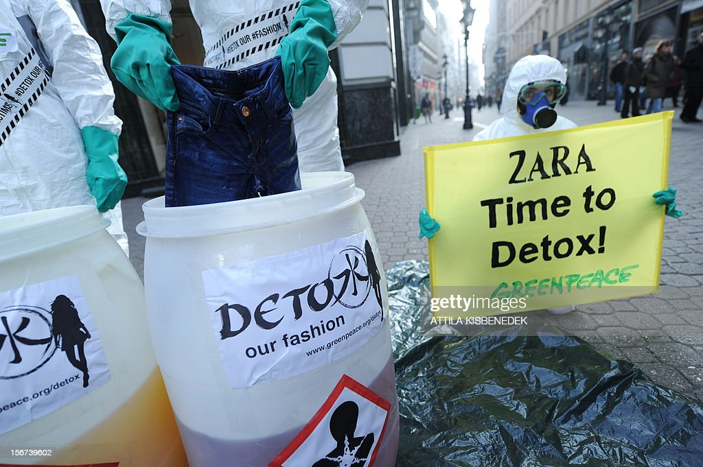 Greenpeace activists protest in front of Zara's store in Budapest on November 20, 2012. High street fashion brands are selling clothing contaminated with hazardous chemicals that break down to form hormone-disrupring or even cancer-causing chemicals when released into the emviroment, according to report released today by Greenpece International.