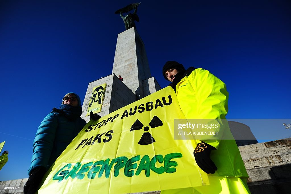 Greenpeace activists protest with their anti-nuclear banner on the monument of Freedom Statue at the Gellert Hill of Budapest on February 3, 2014 during their demonstration against Hungarian government's energy policy and a plan to expand the country's nuclear power plant of Paks. The demonstrators aimed to call attention to the planned process of lifetime extension and expansion of the Hungarian Nuclear Power Plant in Paks, claiming to stop this plans. Representatives of the Hungarian Parliament discuss the expansion plan of Paks power plant today and tomorrow. The text reads 'The memory of all those who sacrified their lives for independence, for freedom and prosperity of Hungary.'