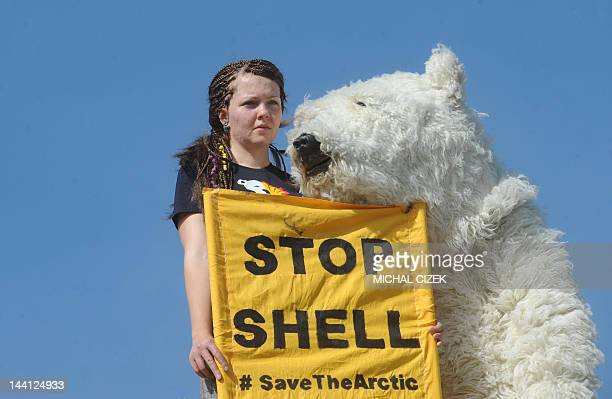 Greenpeace activists stage a protest on May 10 2012 on the roof of a Shell petrol station in Prague against the heading of the an icebreaker for...