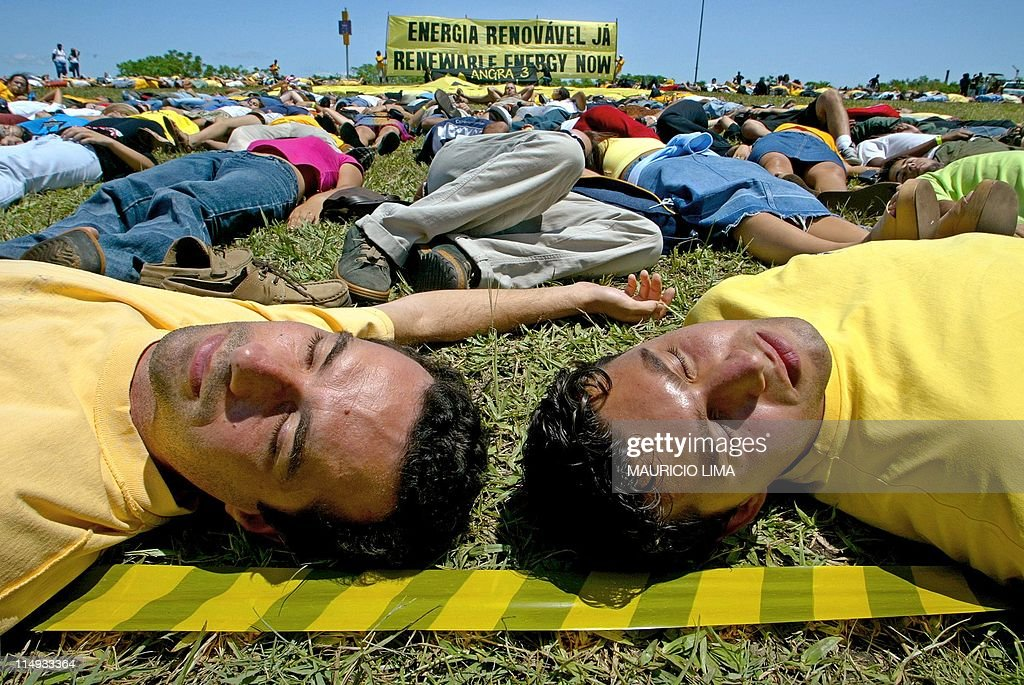 Greenpeace and antiglobalization activists from around the world sham to be dead during a protest against nuclear energy at the III World Social...