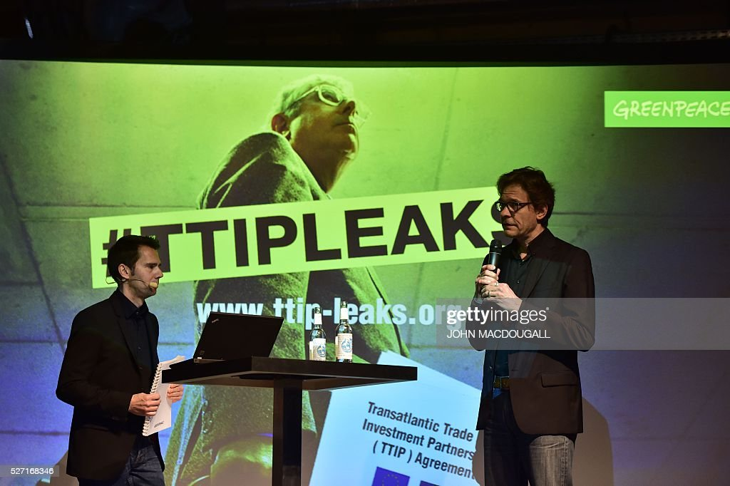 Greenpeace Communication Officer, Volker Gassner (L) and the leader of Greenpeace's political department Stefan Krug, give a press conference where the organisation presented classified papers from ongoing US-EU trade talks on May 2, 2016 in Berlin, at the re:publica conference on internet and society. Greenpeace published documents showing that the Transatlantic Trade and Investment Partnership (TTIP) poses 'major risks for climate, environment and consumer safety'. / AFP / John MACDOUGALL