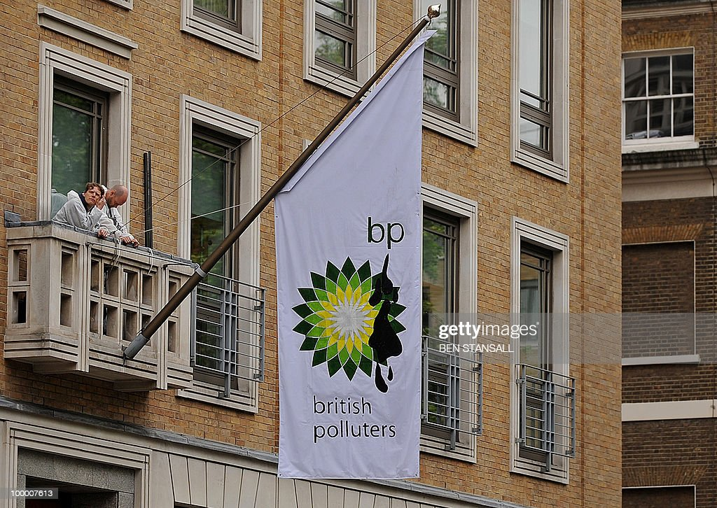 Greenpeace demonstrators, stand on a balcony after they scaled and then hung a flag reading 'British Polluters' at the British Petrolium (BP) headquarters in central London, on May 20, 2010. British energy group BP said on Thursday that it was retrieving about 3,000 barrels of oil per day, or 60 percent of the flow, from the enormous oil leak in the US Gulf of Mexico.