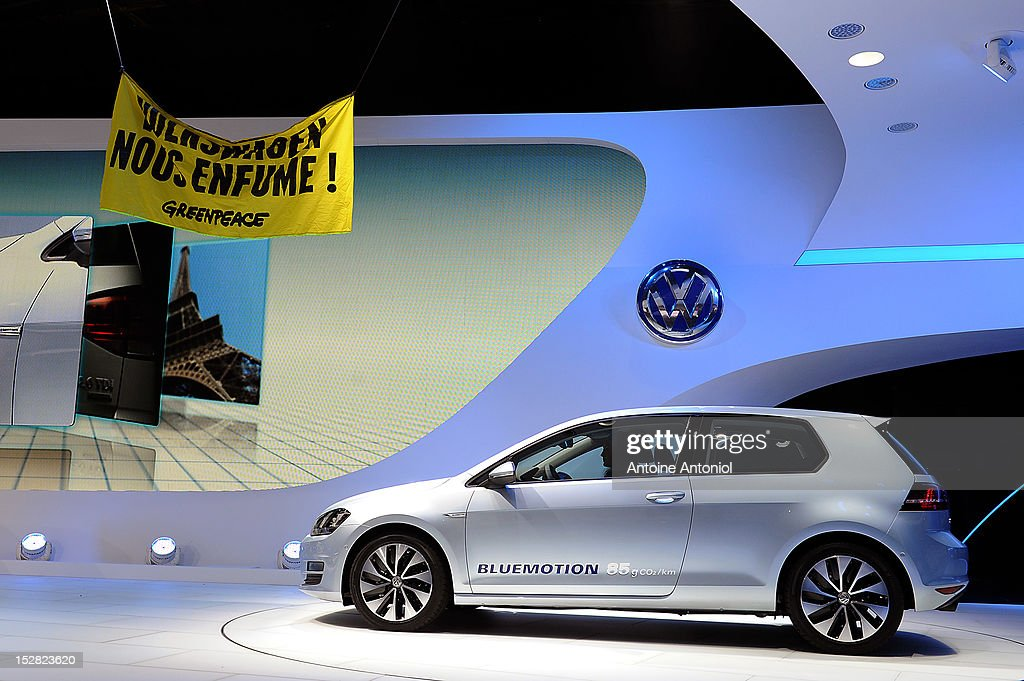 A Greenpeace flag is suspended from the ceiling during the presentation of the new Golf VII at the Paris Auto Show on September 27, 2012 in Paris, France. Volkswagen is hoping the new Golf will help the company to overtake GM and Toyota as the world's largest automaker.