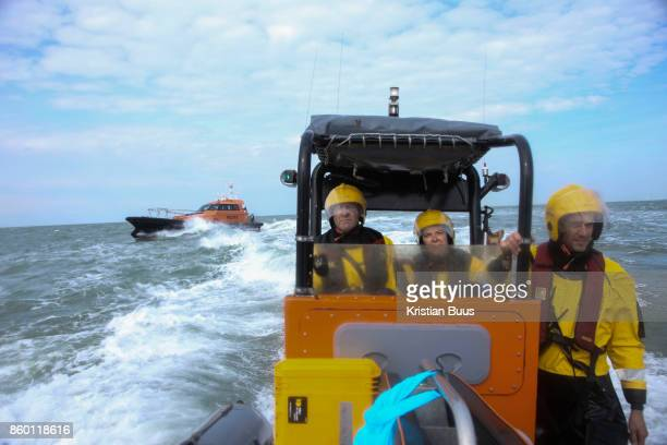Greenpeace monitoring the climbers scaling the cargo ship with a pilot boat leaving the scene September 21st 2017 Thames Estuary Kent United Kingdom...