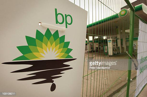 Greenpeace poster displaying a leaking oil logo is placed on a fence after activists closed a BP petrol station in Camden on July 27 2010 in London...