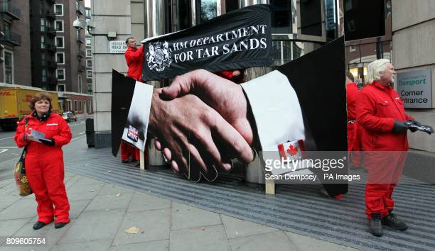 Greenpeace protesters block the entrance to the Department for Transport in Horseferry Road London after they claimed documents released showed how...