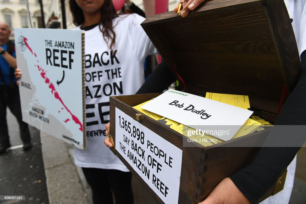 Greenpeace protestors prepare to hand over signed petitions to door staff at the BP headquarters during a protest parade in St. Jame's Square on August 21, 2017 in London, England. The Greenpeace parade of inflatable sea creatures is making its way to the BP headquarters to protest at their plans to drill for oil near the recently discovered Amazon Reef, a 5000km2 coral reef in the Amazon Mouth Basin off the coast of Brazil.