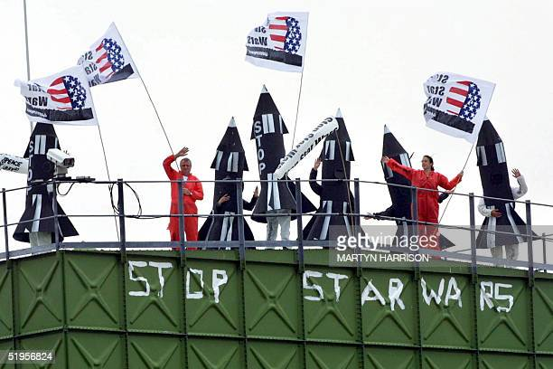 Greenpeace protestors stands on top of the watertower on Menwith Hill Royal airforce base in Yorkshire some 350 km north of London after invading it...
