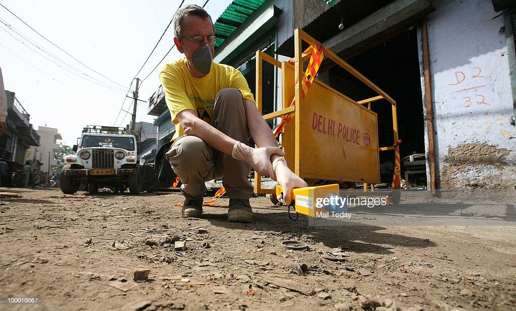 Greenpeace scientist Jan Vande Putte investigates at the Mayapuri scrap market in New Delhi on May 19, 2010.