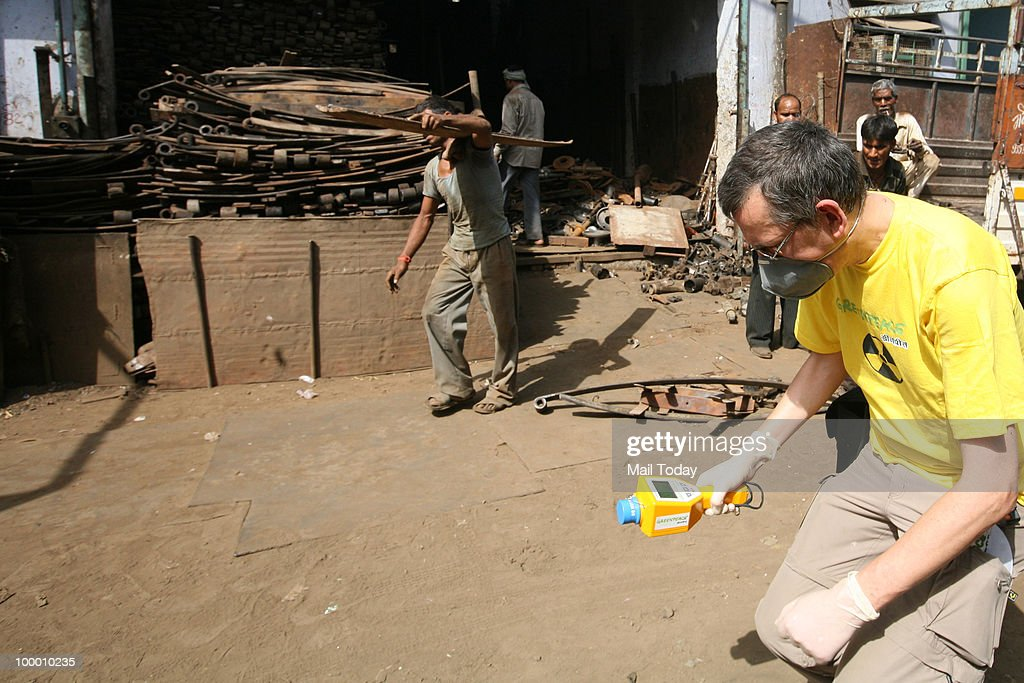 Greenpeace scientist Jan Vande Putte investigates at the Mayapuri scrap market in New Delhi on May 19, 2010.