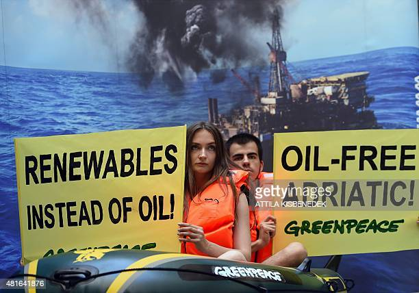 Greenpeace supporters protest against planned oil exploration in the Adriatic in Budapest on July 22 2015 as their campaign is launched to collect...