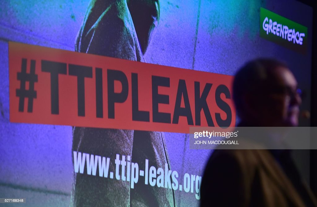 Greenpeace trade expert Juergen Knirsch gives a press conference to present classified papers from ongoing US-EU trade talks on May 2, 2016 at the re:publica conference on internet and society in Berlin. Greenpeace published documents showing that the Transatlantic Trade and Investment Partnership (TTIP) poses 'major risks for climate, environment and consumer safety'. / AFP / John MACDOUGALL
