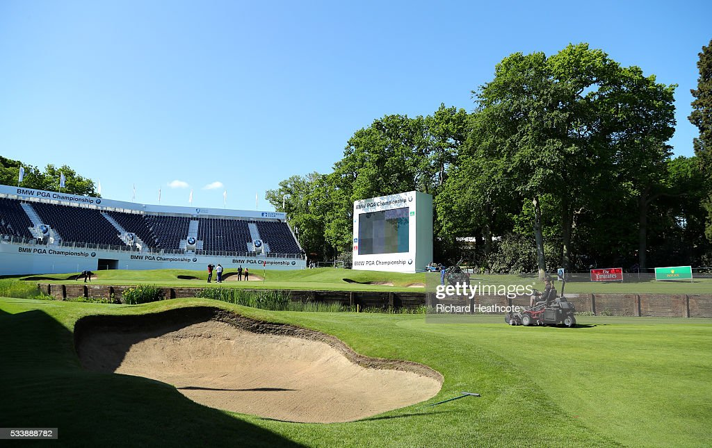 Greenskeepers prepare the 18th hole during a practise round for the BMW PGA Championship at Wentworth on May 24, 2016 in Virginia Water, England.