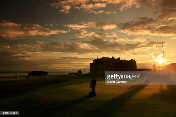Greenstaff mowing the green on the par 4 18th hole at sunrise on the Old Course at St Andrews venue for The Open Championship in 2015 on July 29 2014...
