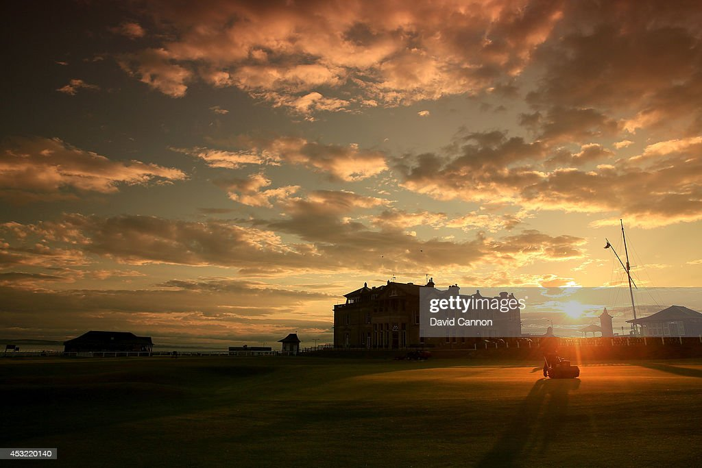 Greenstaff mowing the green on the par 4, 18th hole at sunrise on the Old Course at St Andrews venue for The Open Championship in 2015, on July 29, 2014 in St Andrews, Scotland.