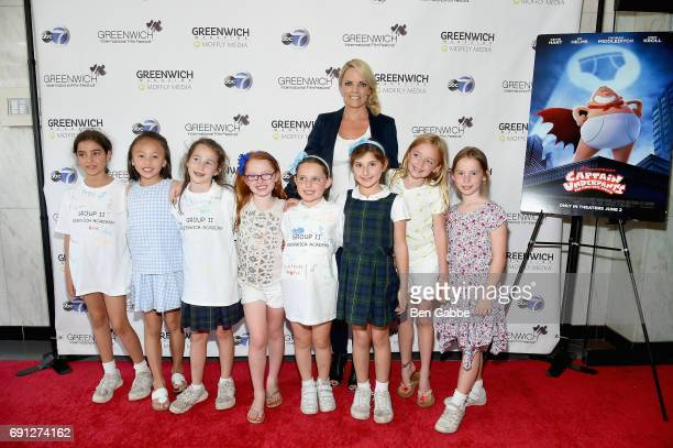 Greenwich International Film Festival Executive Director COO Ginger Stickel poses with moveigoers at the screening of Captain Underpants during...