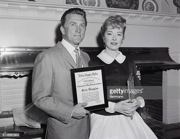 Greer Garson and Kirk Douglas hold their 'Distinguished Film Achievement Awards' given to them by the motion picture fraternity of UCLA Delta Kappa...