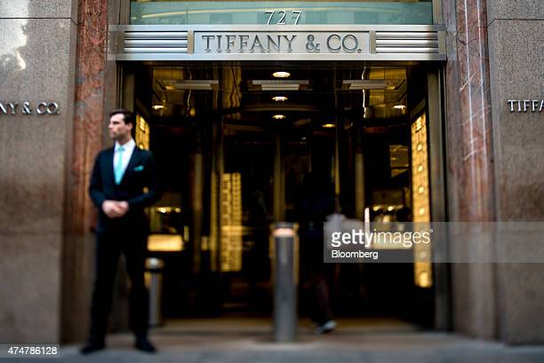 A greeter stands outside the Tiffany Co flagship store on 5th Avenue in this photo taken with a tiltshift lens in New York US on Friday May 22 2015...