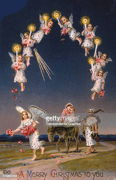 Greeting card features an illustration of a Biblical scene in which a group of angels with candles illuminate the path for Joseph Mary and the infant...