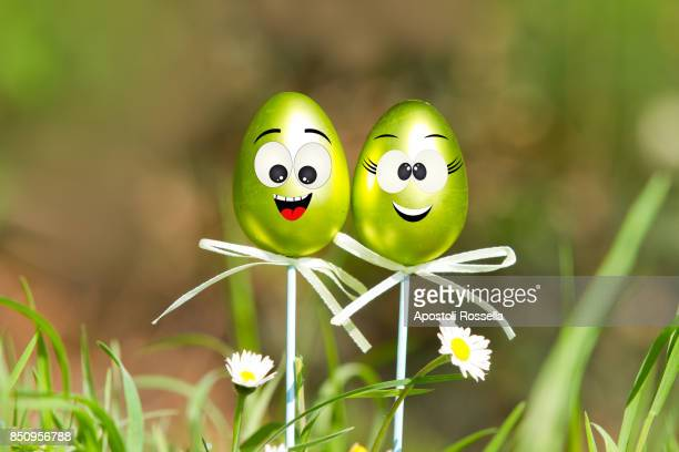 Greeting postcard for Easter with decorate eggs in the grass