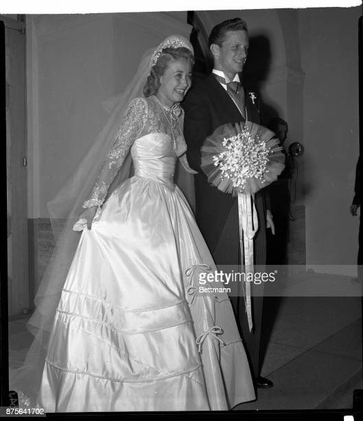 Greeting the crowd outside the Church of the Good Shepherd in Beverly Hills CA after their wedding are film actress Jane Powell and Geary Stephen 26...