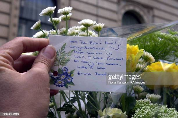 A greetings card with flowers delivered to number 10 Downing Street for the Prime Minister Tony Blair and his wife Cherie who is resting after giving...