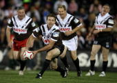 Greg Alexander of the Panthers legends passes in the legends Curtain raiser match before the round 22 NRL match between the Penrith Panthers and the...