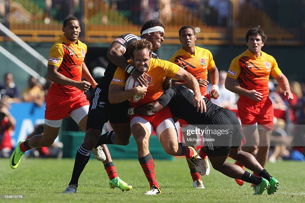 Greg Barden of England is tackled by <a gi-track='captionPersonalityLinkClicked' href=/galleries/search?phrase=Lote+Raikabula&family=editorial&specificpeople=596928 ng-click='$event.stopPropagation()'>Lote Raikabula</a> (L) and Tomasi Cama (R) of New Zealand during the Quarter Final match between England and New Zealand during Day Three of the IRB Dubai Sevens at the Sevens Stadium on December 3, 2011 in Dubai, United Arab Emirates.