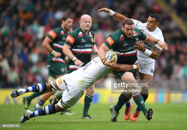 Greg Bateman of Leicester Tigers is tackled by Taulupe Faletau of Bath Rugy during the Aviva Premiership match between Leicester Tigers and Bath...