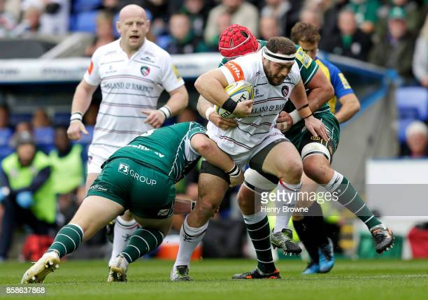 Greg Bateman of Leicester Tigers tackled by Petrus Du Plessis of London Irish and Sebastian de Chaves of London Irish during the Aviva Premiership...