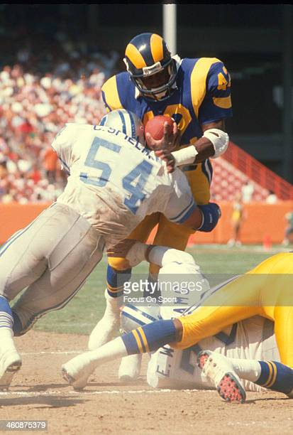 Greg Bell of the Los Angeles Rams gets tackled by Chris Spielman of the Detroit Lions during an NFL football game September 11 1988 at Anaheim...